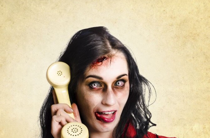 Woman zombie answering phone