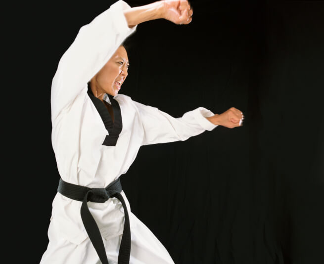 Young Woman in Karate Pose