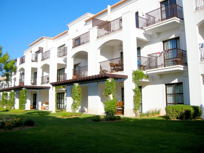 white luxury condo and lawn