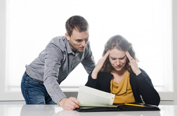 Man and woman stressed about finances
