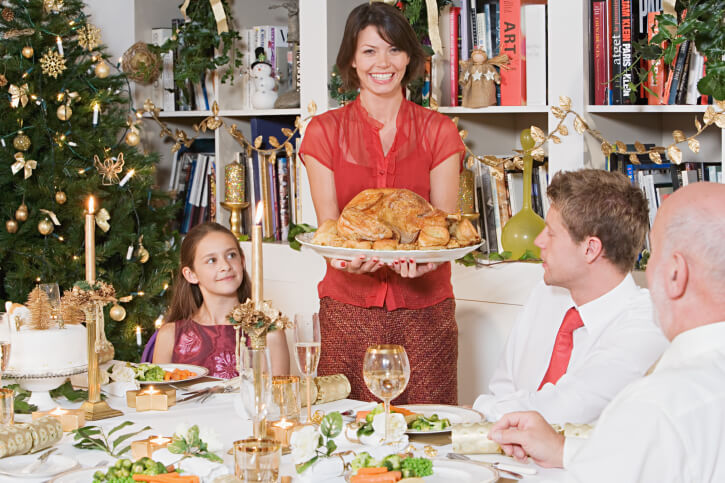 Family at dining table at Christmas