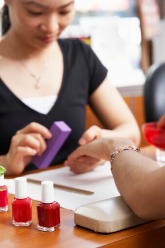 Salon Worker Buffing Fingernails