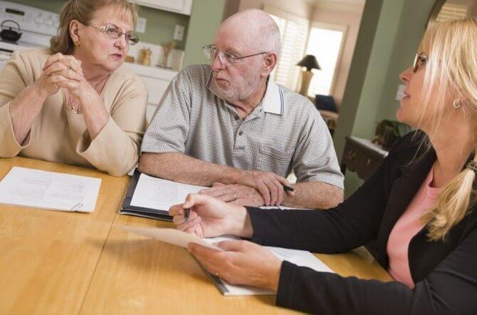 Elderly couple with financial advisor