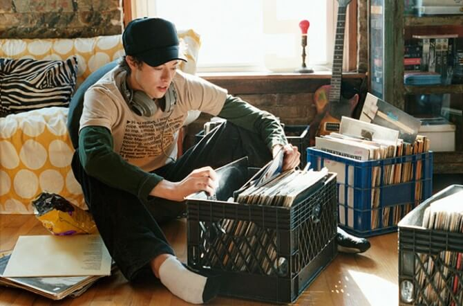 man with cap sitting in apartment