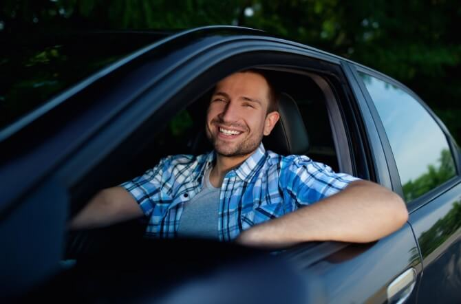 Man sitting in a new car