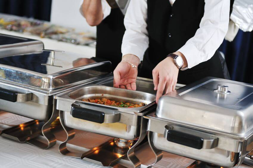 caterers setting up buffet station
