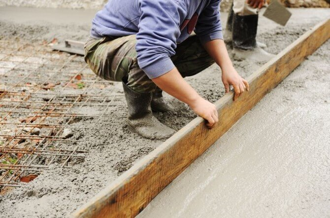 man laying foundation
