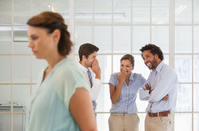 Woman being defamed by coworkers