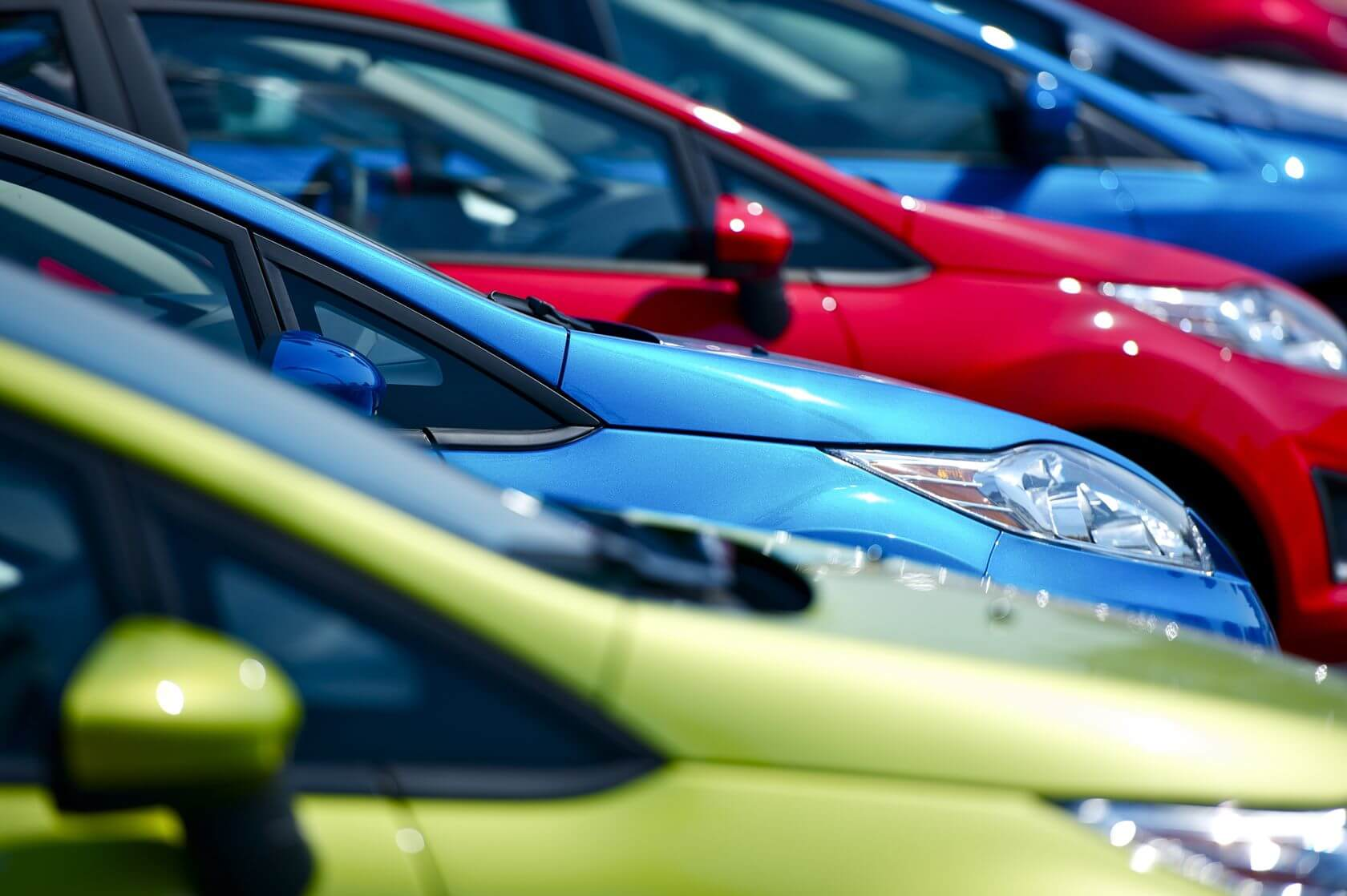 Row of new vehicles at a dealership