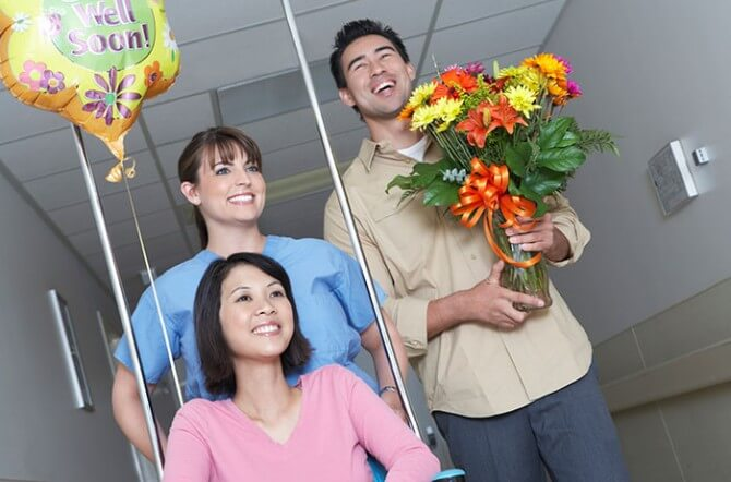 couple at hospital with flowers
