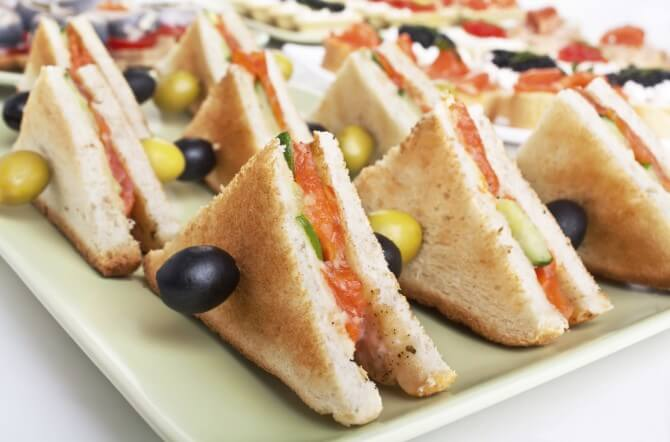 finger sandwiches on plate
