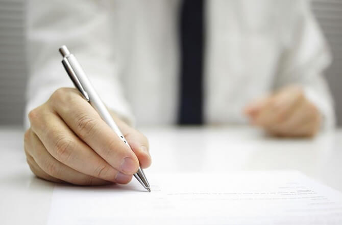 Insurance documents and pen