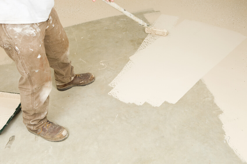 worker painting concrete