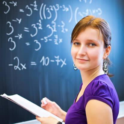 College student writing on the chalkboard/blackboard