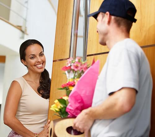 man delivering flowers to woman