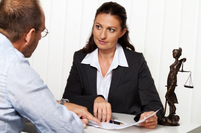 attorney with client at a desk