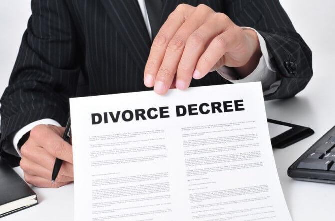 man holding divorce decree