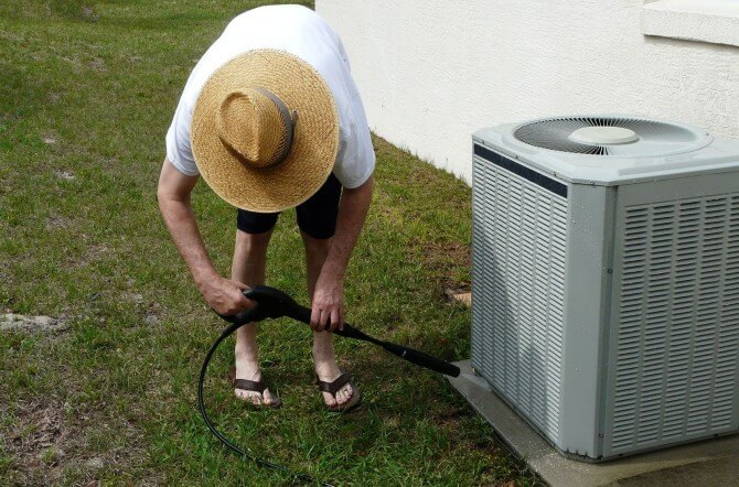 Man cleaning A/C Unit