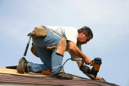roofer - man repairing roof