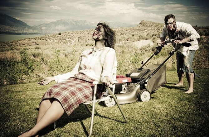 Zombie man mowing lawn while zombie wife relaxes