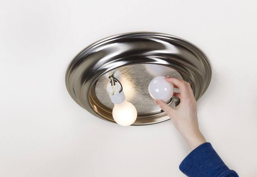 Person changing lightbulb