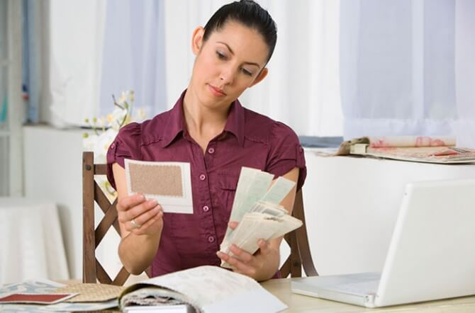 woman comparing paint color samples
