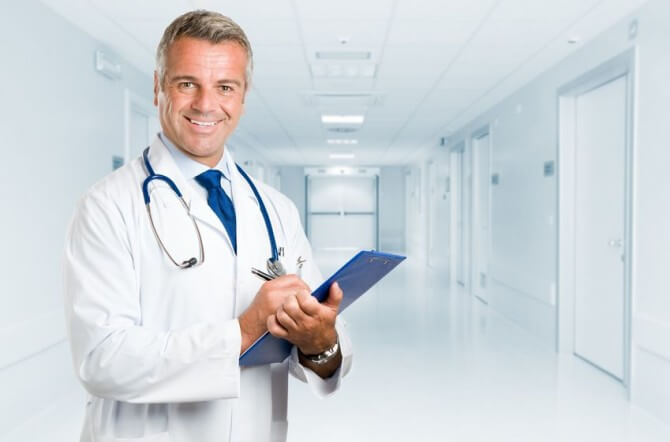 doctor standing and holding clipboard