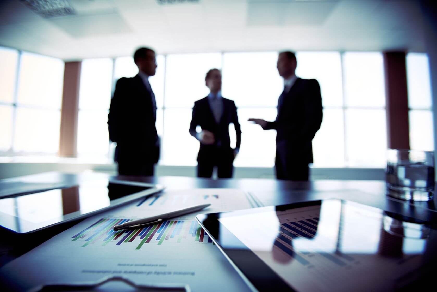 Men meeting in boardroom
