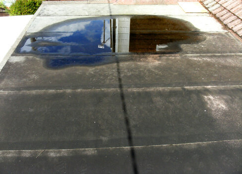 Image of a flat roof in need of repair