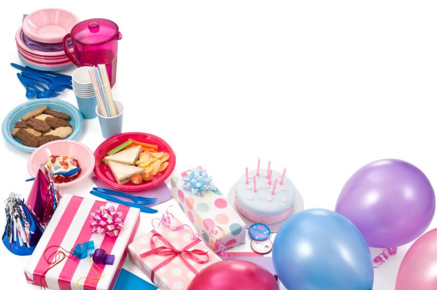 birthday party supplies on white background