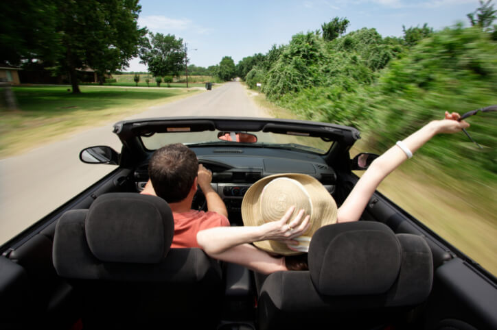 Couple Driving Down Country Road