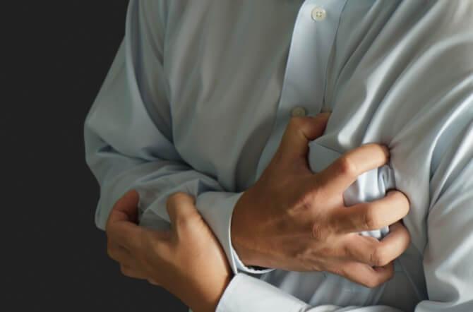 Man grabbing his chest