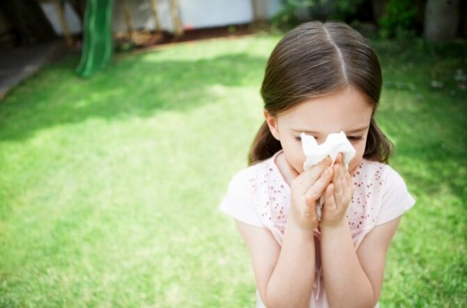 Girl Blowing Nose In Backyard