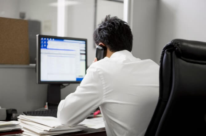 man in office on the telephone