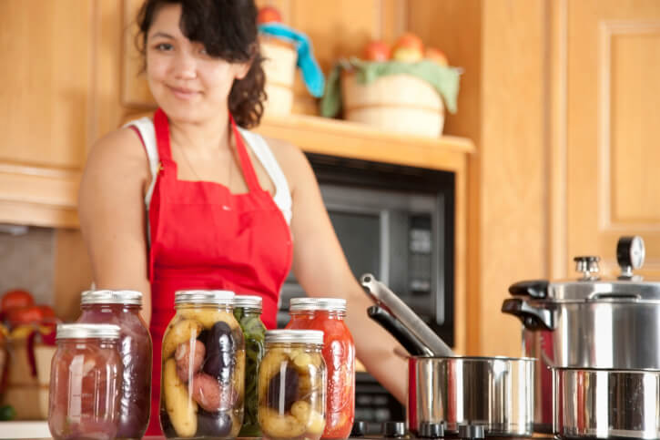 Canning: Mixed Race Young Adult Woman Preserving Homegrown Fruit Vegetables