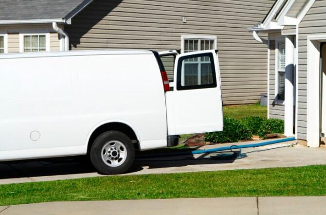 white van outside garage