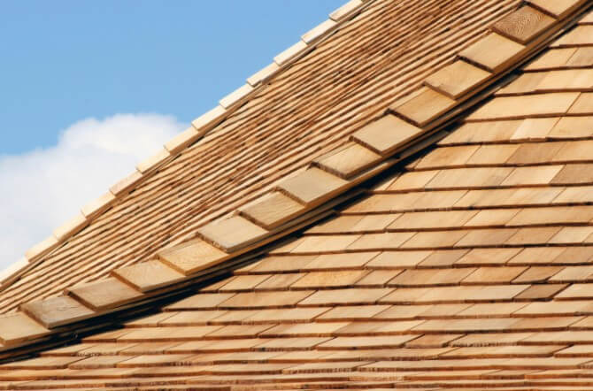 cedar roof with clouds in background