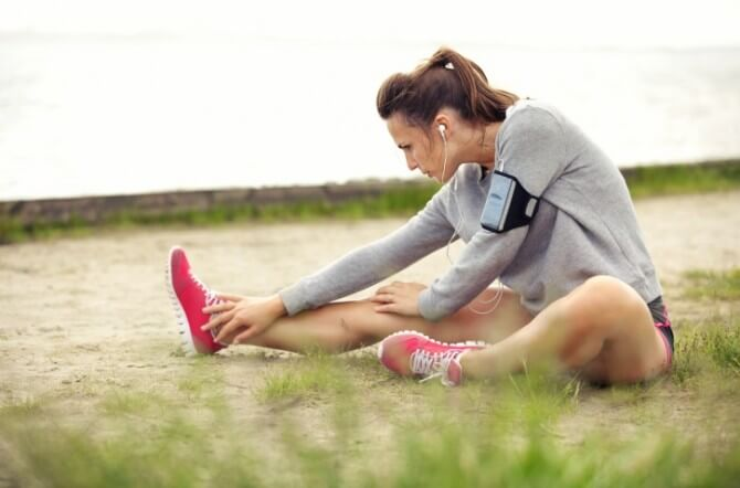 woman stretching with headphones